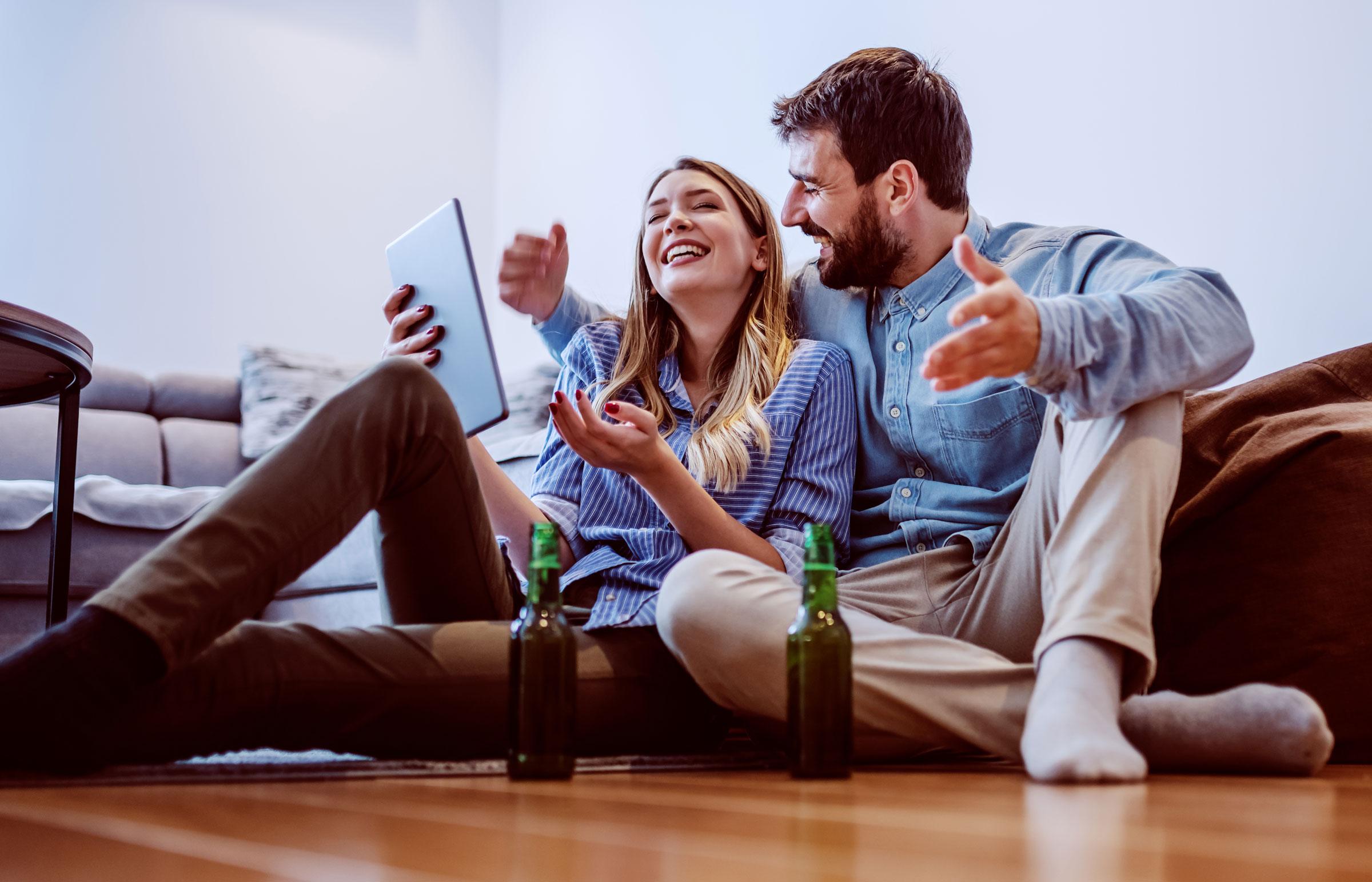 happy couple using high speed broadband